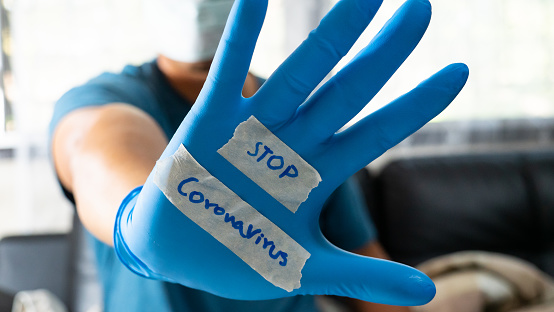 istock The glove-wearer has a message to stop the Coronavirus 1202181414