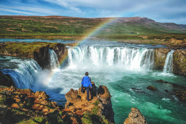 The Godafoss (Icelandic: waterfall of the gods) is a famous waterfall in Iceland. The breathtaking landscape of Godafoss waterfall attracts tourist to visit the Northeastern Region of Iceland. stock photo