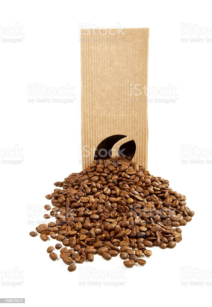 The goffered cardboard box with coffee grains royalty-free stock photo