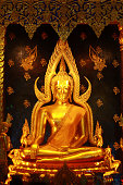 The gold buddha statue is a Buddhist worship.