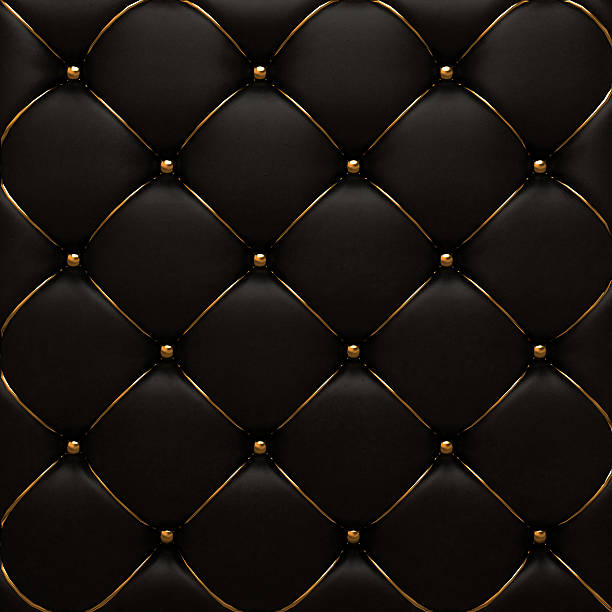 The gold leather texture of the quilted skin stock photo