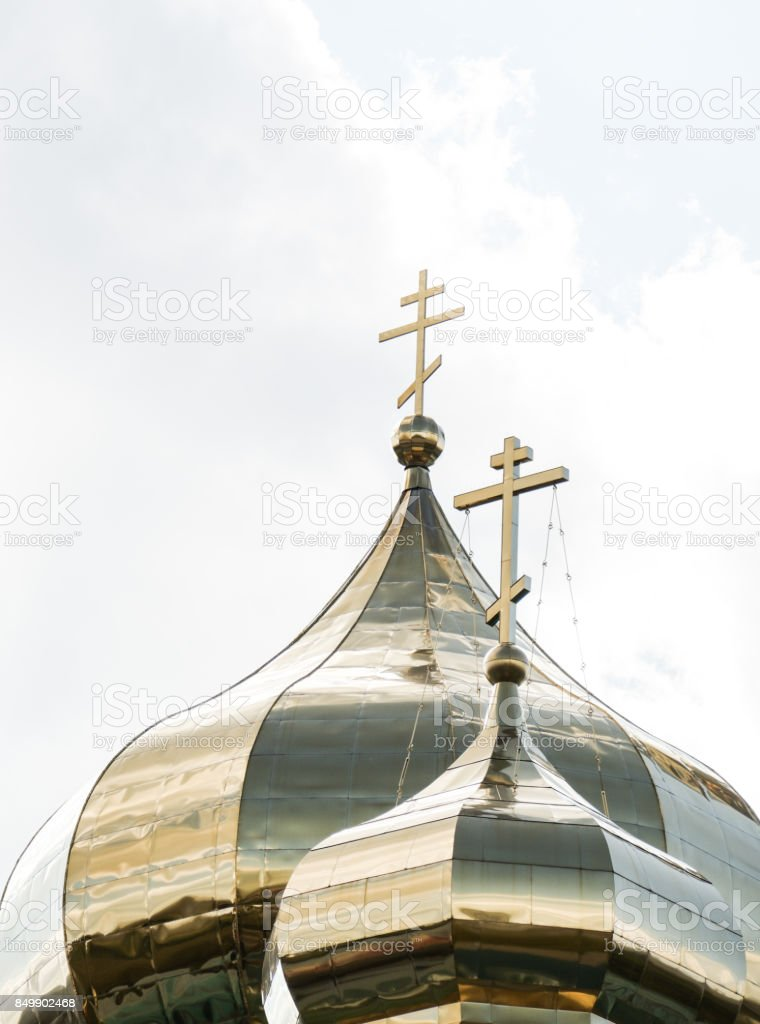 The Golden Church Dome of the Orthodox Church over sky with clouds stock photo