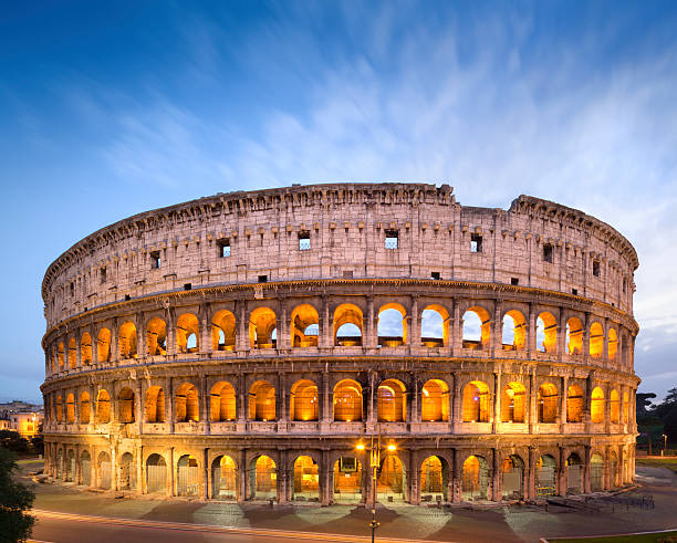 The Golden Colosseum at dusk in Rome, Italy  Coliseum -The Flavian Amphitheater in Rome, Italy coliseum rome stock pictures, royalty-free photos & images