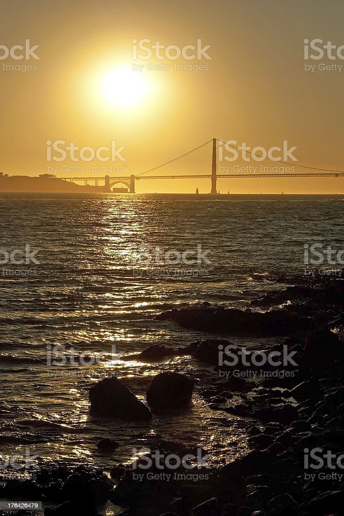 The Golden Gate Bridge in San Francisco during sunset royalty-free stock photo