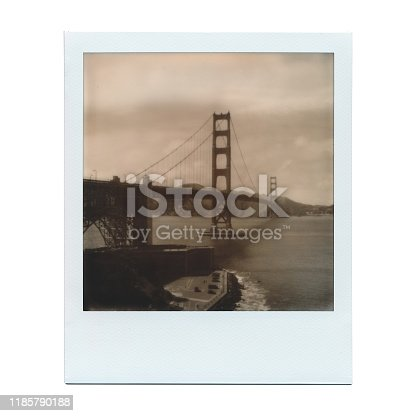 Black and white Polaroid film photo of the Golden Gate Bridge in San Francisco California