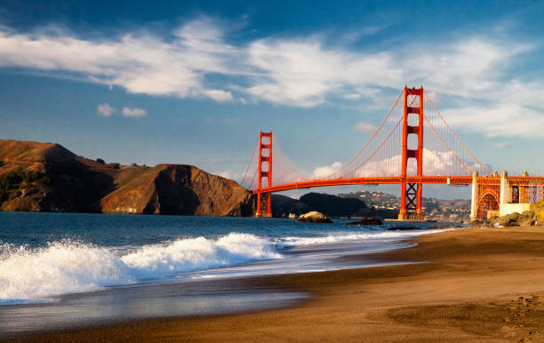 The Golden Gate Bridge w the waves The Golden Gate Bridge in San Francisco bay golden gate bridge stock pictures, royalty-free photos & images