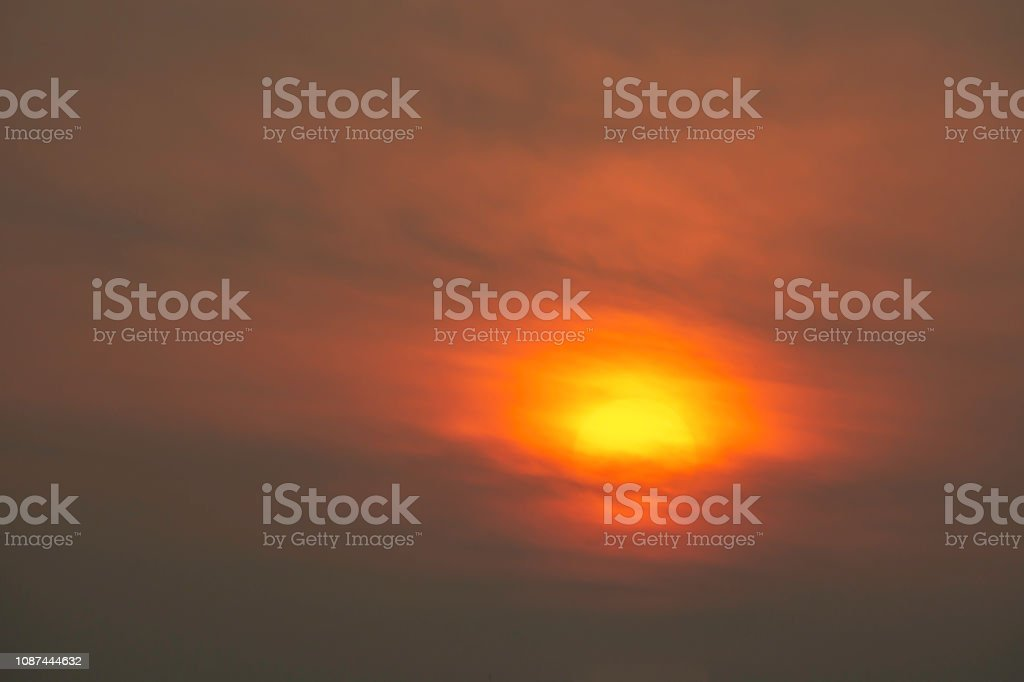 The golden light of the sun and clouds in the sky. stock photo