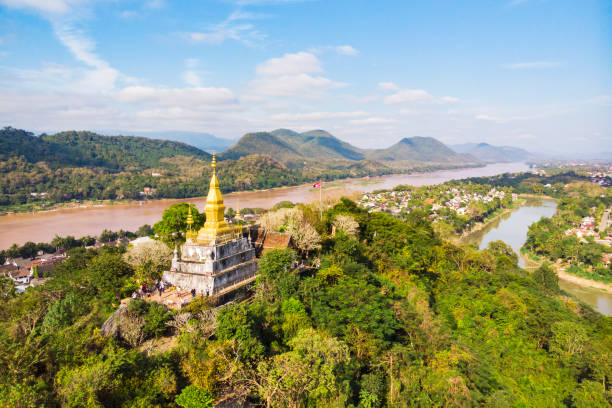 The golden pagoda of Wat Chom Si on the top of Mount Phou Si, Luang Prabang, Lao stock photo
