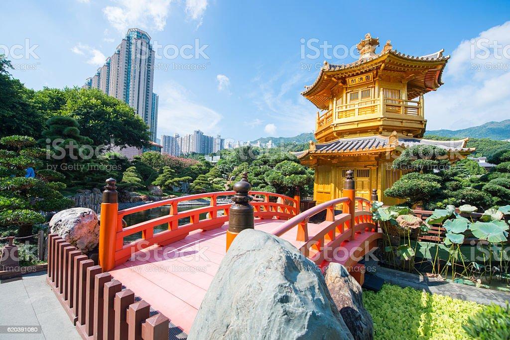 The golden pavilion and red bridge at Nan Lian garden stock photo