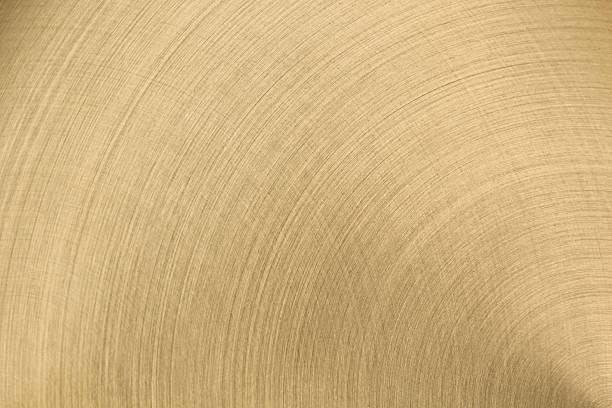 La surface en métal poli doré. - Photo