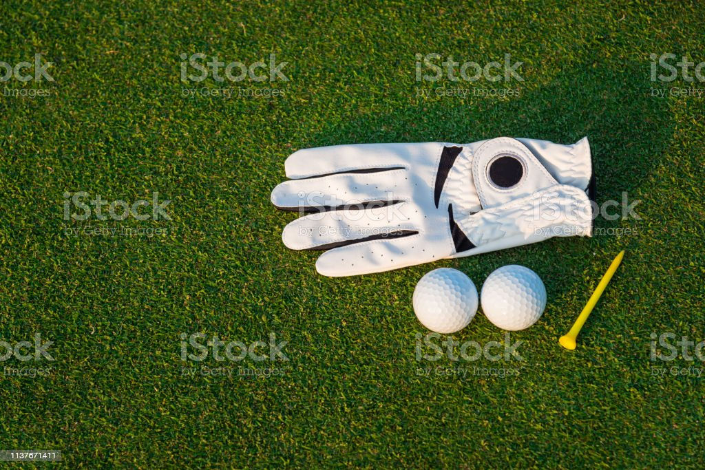 The golf sport equipment white glove ,golf ball, golf club and yellow...