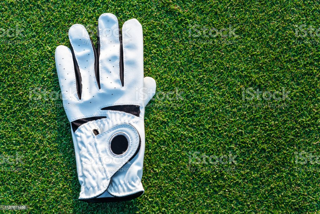 The golf sport equipment white glove ,golf ball with green grass...