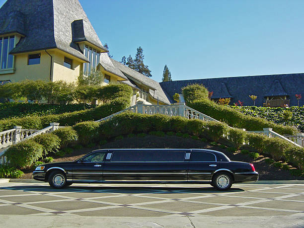 the good life: limousine & mansion - limousine service stock photos and pictures
