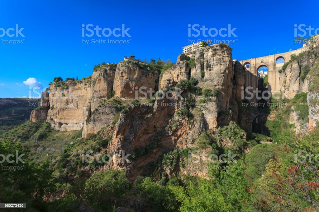 The gorge, bridge and town of Ronda in Andalucía, Spain. stock photo