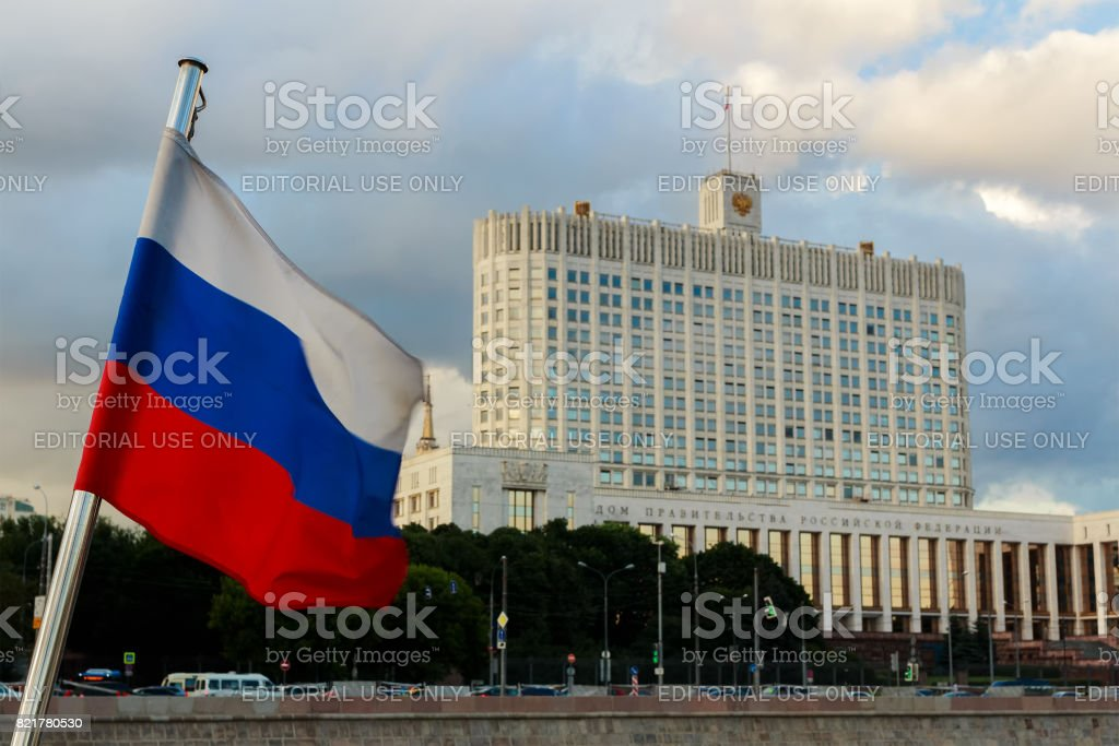 The government House of the Russian Federation. The government on the background of the Russian flag. stock photo