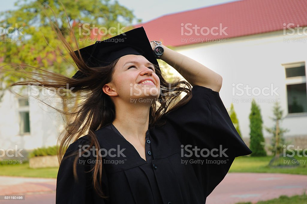 The graduate in the mantle looks up stock photo
