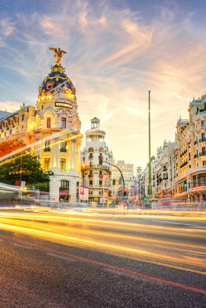 The Gran Via Downtown Madrid, Spain, where the Calle de Alcala meets the Gran Via. These are two of the most famous and busy streets in Madrid. urban sprawl stock pictures, royalty-free photos & images