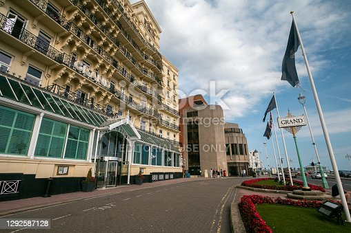 Several people and identifiable cars can be seen outside The Grand Brighton Hotel, which is a privately owned business on the Brighton seafront. The hotel was designed in 1862-64 by John Whichcord Jr and was aimed at the wealthy.