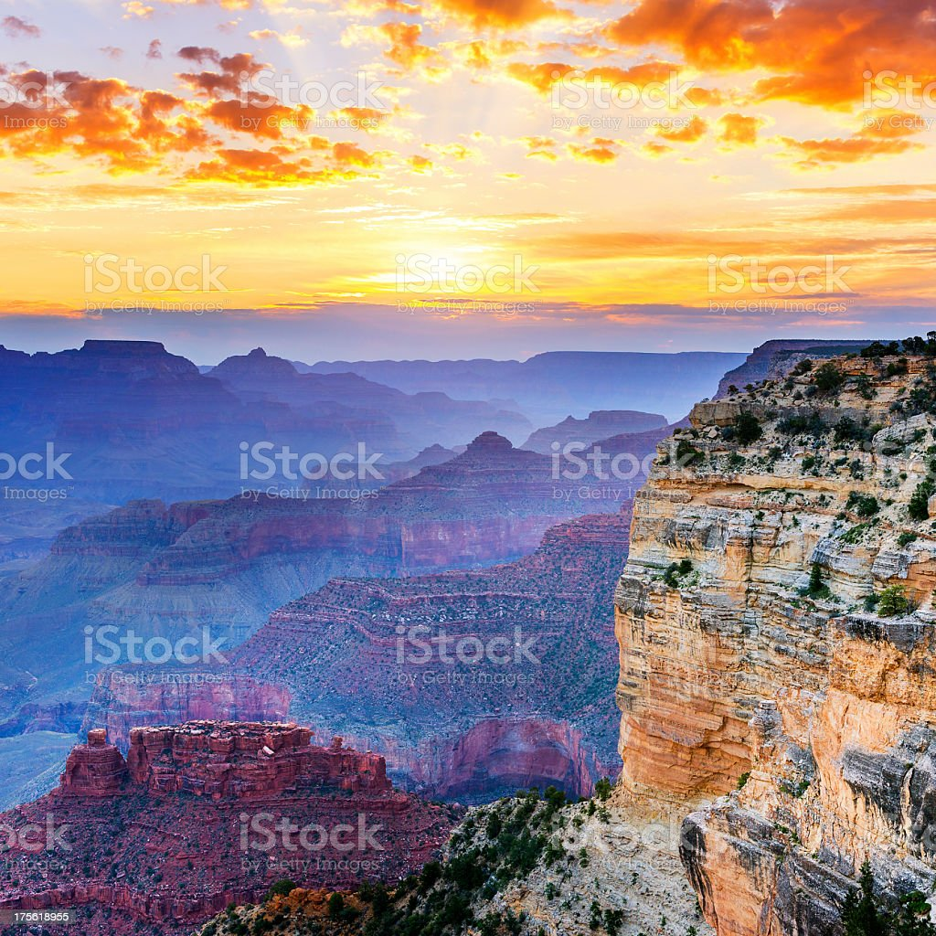The Grand Canyon in hues of blue and purple at sunset stock photo