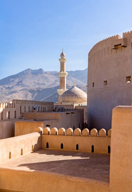 the grand mosque and minaret in nizwa - oman. - oman стоковые фото и изображения