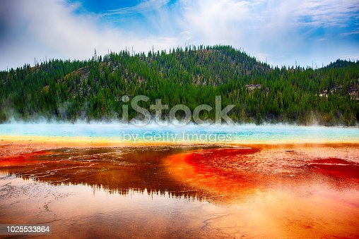 Located in Yellowstone National Park, Wyoming, the largest hot spring in the United States and third larges in the world.  The amazing colors are actually the heat loving microbes in the pools.