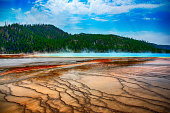 Located in Yellowstone National Park, Wyoming, the largest hot spring in the United States and third largest in the world.  The amazing colors are actually varying species of heat loving microbes in the pools - each having a different color and existing at a different temperature.