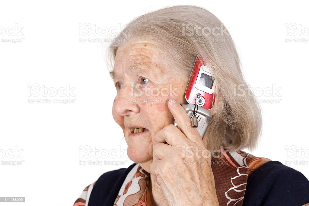 The grandmother, speaks by phone stock photo