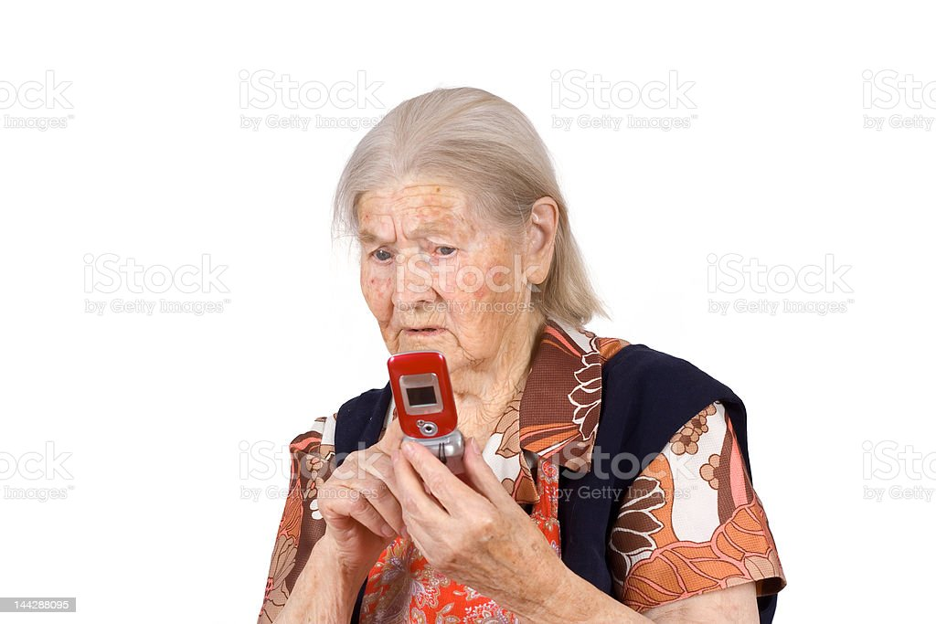 The grandmother studies phone stock photo