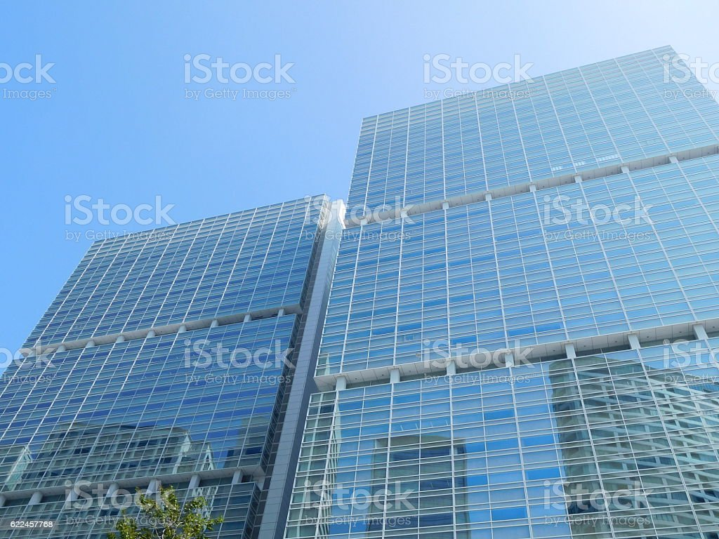 The grassed office buildings under the blue sky stock photo