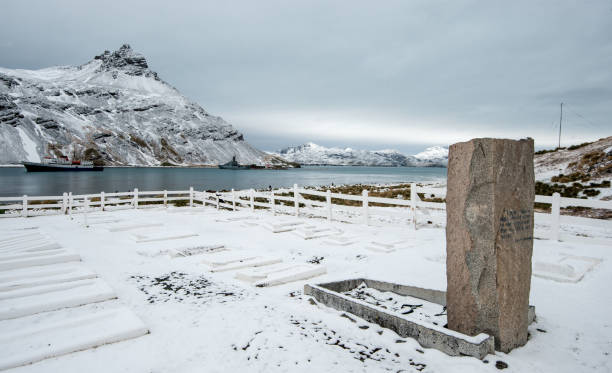 The grave of Sir Ernest Shackleton in South Georgia The grave of Sir Ernest Shackleton covered by snow at the former whaling station of Grytviken, South Georgia south georgia island stock pictures, royalty-free photos & images