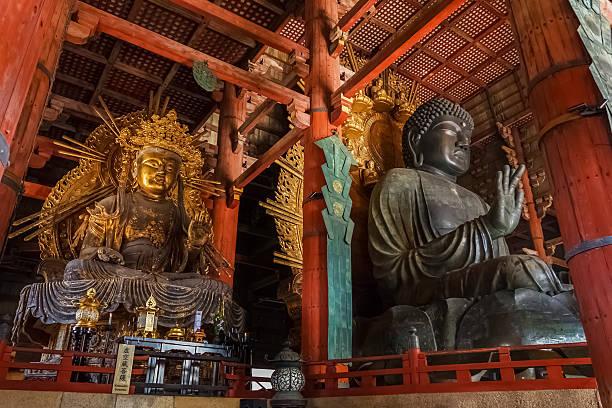 The Great Buddha and kokuzo bodhisattva at Todaiji Temple Nara, Japan - November 16 2013: Daibutsu-den houses the world's largest bronze statue of the Buddha Vairocana and other two Bodhisattava bodhisattva stock pictures, royalty-free photos & images