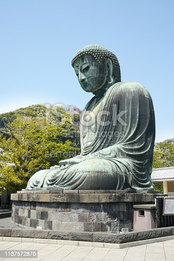 Kamakura, Japan - April 10, 2014: The Great Buddha of Kamakura monumental bronze statue, one of the most famous icons and attractions of Japan