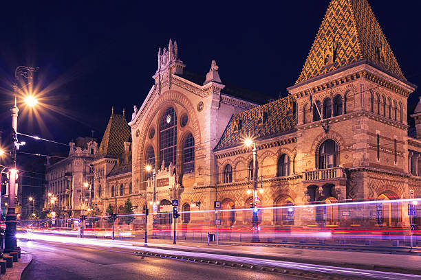 The Great Market Hall of Budapest The Great Market Hall in Budapest at night. market hall stock pictures, royalty-free photos & images