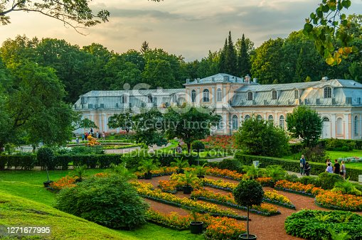 the Great orangery at the Great Peterhof Palace at sunset. Large greenhouse in Peterhof Lower park in summer. Saint Petersburg, Russia, August 2018