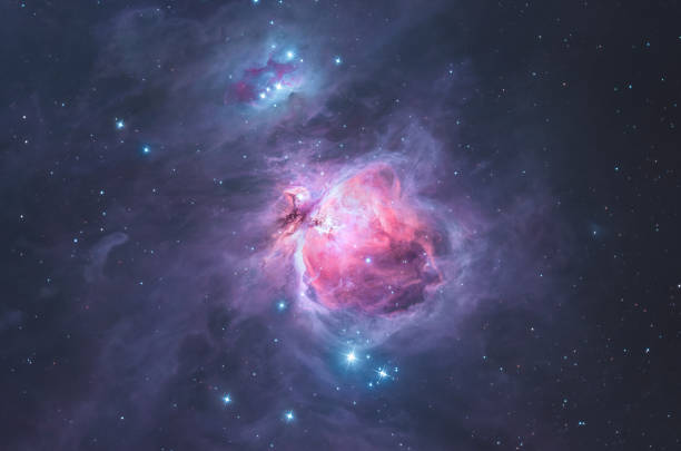 The Great Orion nebula in the constellation Orion / the hunter An astronomical long time exposure, taken at the Baerenstein Observatory in Baerenstein, Germany. The Orion Nebula is a diffuse nebula situated in the Milky Way, being south of Orion's Belt in the constellation of Orion. It is one of the brightest nebulae, and is visible to the naked eye in the night sky. nebula stock pictures, royalty-free photos & images