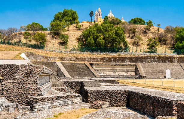 The Great Pyramid and the Our Lady of Remedies Church in Cholula, Mexico Ruins of the Great Pyramid and the Nuestra Senora de los Remedios Church in Cholula, Mexico puebla state stock pictures, royalty-free photos & images