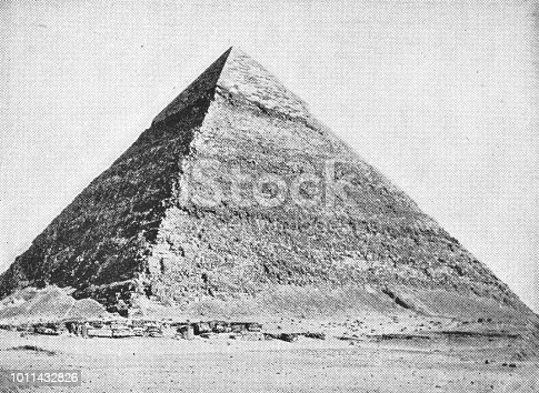 Pyramid of Khufu at the Great Pyramids in Giza, Egypt. Vintage halftone photo etching circa late 19th century.