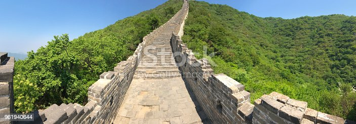 The scenic panoramic view of the Great Wall of China at the Mutianyu location just outside of Beijing, China. The Great Wall of China, a historic site and a very popular international tourist destination.