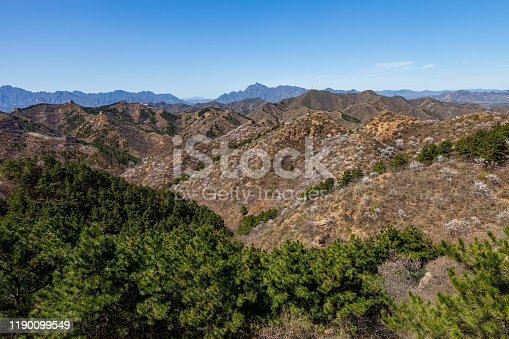 The Great Wall of China meanders on the mountain and is a fortress on the mountain