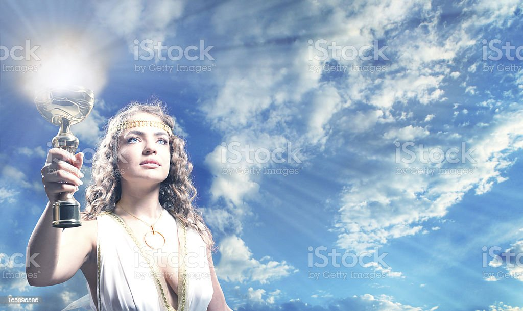 The Greek Goddess Carrying a Goblet of Fire. stock photo