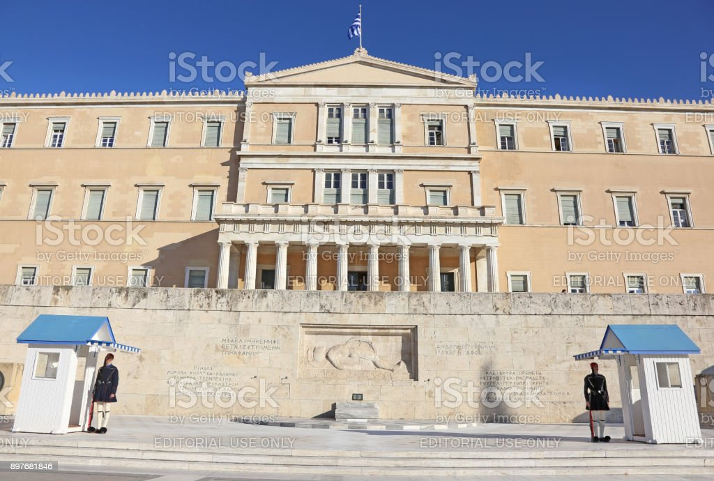 the greek parliament and the Evzones soldiers guarding the presidential mansion stock photo