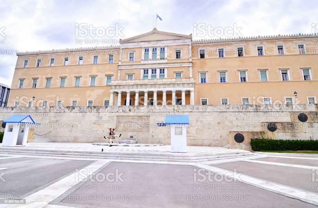 the greek parliament with the greek Evzones soldiers Syntagma Athens Greece stock photo