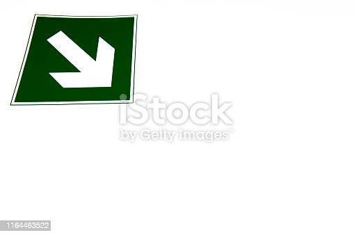 The green arrow indicates the direction on a white background. Isolated. Background image. Place for text.