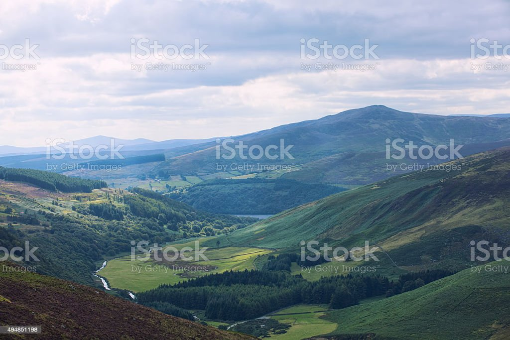 The green irish mountains with the cloudy white sky stock photo