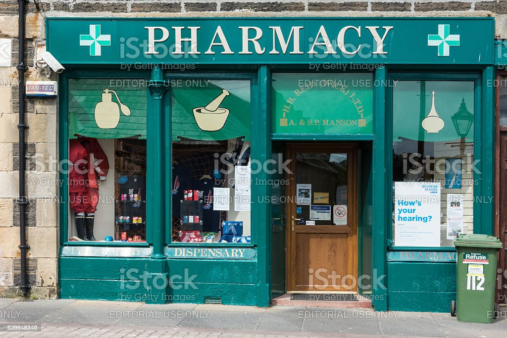 The green painted storefront of Wick Pharmacy, Scotland. stock photo