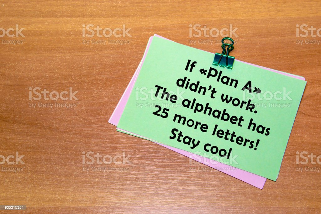 The green sticker with a paperclip, isolated on wooden background. If 'Plan A' didn't work, the alphabet has 25 more letters. stock photo