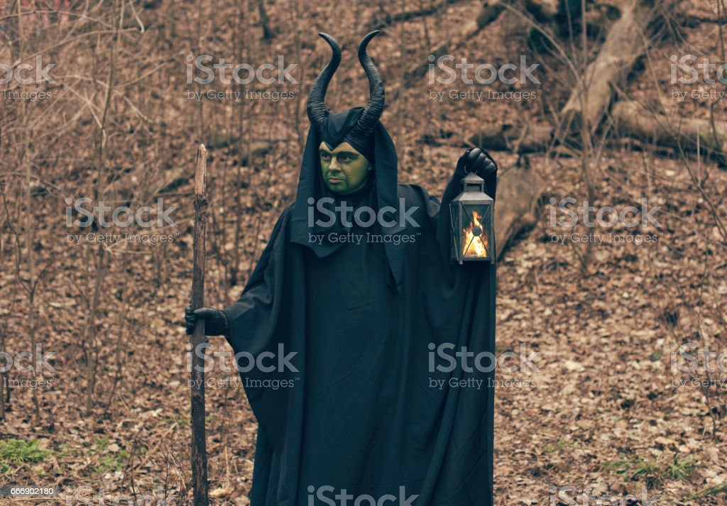 the green witch in the autumn forest stock photo
