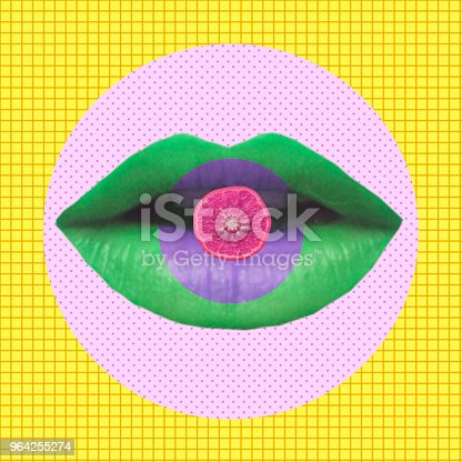 1014178164 istock photo The green woman's lips hold the fruit orange. 964255274
