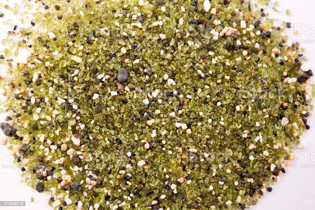 The greenest Papakolea Beach sand closeup on white royalty-free stock photo