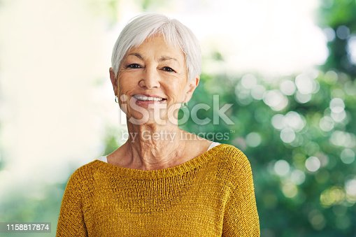 Shot of a confident senior woman standing in her home